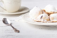Homemade savory hand pies with cup of tea, breakfast concept Royalty Free Stock Photography