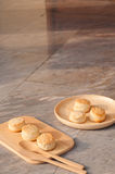 Homemade scone on the wood plate. Blur background Stock Photos
