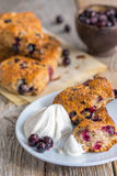 Homemade scones with berries and cream. Stock Photos