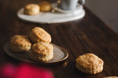 Homemade scones with cheese in rustic setting Stock Image