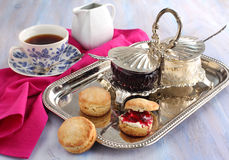 Homemade scones with  jam and double cream. Stock Photo