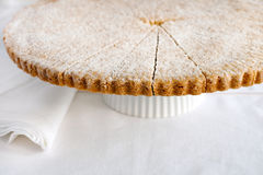 Homemade Scottish shortbread. Freshly baked shortbread circle, cut into petticoat tails (triangular shapes) and sprinkled with fine sugar. Traditional, melt-in Stock Photos