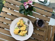 Homemade Scrambled Eggs with Avocado on Toast Bread for Breakfast stock images