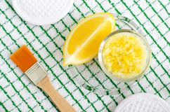 Homemade scrub foot soak or bath salt with lemon juice and zest, sea salt and olive oil. DIY beauty treatments and spa recipe. Top view, copy space stock images