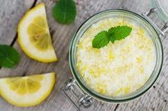 Homemade scrub made of sea salt, lemon peel, lemon juice and essential mint oil. Stock Photo