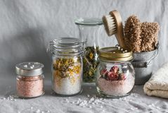 Homemade sea salt bath - calendula, pink himalayan, rose salt and bath accessories. Health, beauty, regeneration, skin cleansing c stock photos