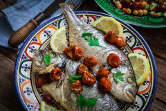 Homemade seabass with parsley Royalty Free Stock Photo