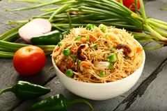 Bowl of uppma,. Homemade semiya uppuma or upma served in bowl.South Indian breakfast dish stock image