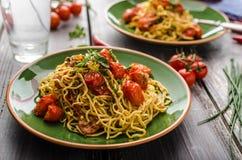 Homemade semolina spaghetti with cherry Royalty Free Stock Photo