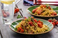 Homemade semolina spaghetti with cherry. Homemade semolina spaghetti with roasted cherry tomatoes and parmesan, fresh lemon limonade Stock Photos