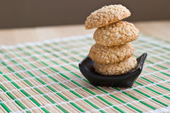 Homemade sesame seed cookies on black plate Royalty Free Stock Photo