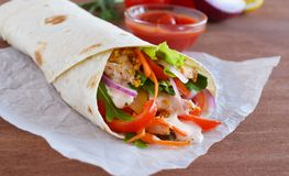 Homemade Shawarma with Chicken Meat fillet and Fresh Vegetables over Wooden Board. cooking Process. Homemade Shawarma with Chicken Meat fillet and Fresh royalty free stock photo