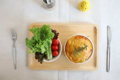 Homemade Shepherd pie , Mash potato with mince bacon and pork and salad. In close up royalty free stock images