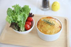 Homemade Shepherd pie , Mash potato with mince bacon and pork and salad. In close up royalty free stock image
