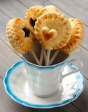 Homemade shortbread cookies pops with chocolate in cup Stock Photography