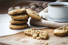 Homemade shortbread and a cup of tea. Homemade shortbread cookies with nuts and a cup of tea Royalty Free Stock Photography
