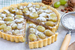 Homemade shortbread dough grape tart with walnut praline, horizontal Royalty Free Stock Photo