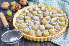 Homemade shortbread dough grape tart with walnut praline, horizontal Stock Image