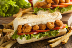 Homemade Shrimp Po Boy Sandwich. With French Fries Royalty Free Stock Photo