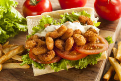 Homemade Shrimp Po Boy Sandwich. With French Fries Stock Photos