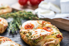 Homemade simple food, foccacia with cheese. Homemade simple food, foccacia with tomato and goats cheese and fresh herbs Stock Photos
