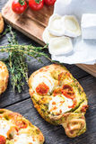 Homemade simple food, foccacia with cheese. Homemade simple food, foccacia with tomato and goats cheese and fresh herbs Stock Image