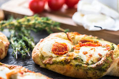 Homemade simple food, foccacia with cheese. Homemade simple food, foccacia with tomato and goats cheese and fresh herbs Stock Photo
