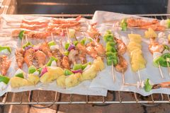 Homemade skewer with delicious grilled shrimps on parchment pape Stock Image