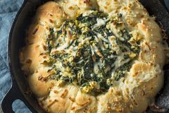 Homemade Skillet Bread with Artichoke Dip Stock Photo