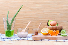 Homemade skin care and body scrub with natural ingredients avoca. Do ,aloe vera ,lemon,cucumber ,orange and honey set up on on  wooden background Royalty Free Stock Photos