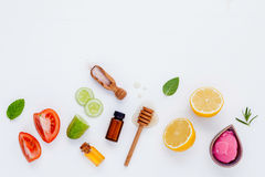 Homemade skin care and body scrubs with natural ingredients aloe. Vera ,lemon,cucumber ,himalayan salt ,tomato,mint ,lime slice,rosemary and honey set up on royalty free stock images