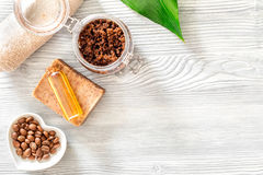 Homemade skin care. Coffee soap, coffee scrub, coffee grains, oil on wooden background top view copyspace Stock Photos