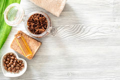 Homemade skin care. Coffee soap, coffee scrub, coffee grains, oil on wooden background top view copyspace Stock Images