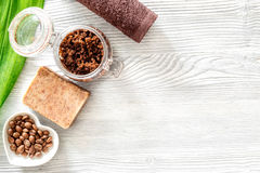 Homemade skin care. Coffee soap, coffee scrub, coffee grains on wooden background top view copyspace Stock Photo
