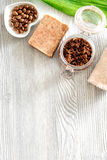 Homemade skin care. Coffee soap, coffee scrub, coffee grains on wooden background top view copyspace Stock Photography