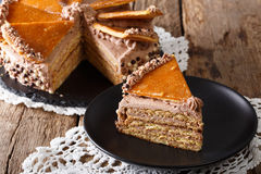 Homemade slice of Hungarian Dobosh cake with caramel close-up. h Stock Image