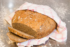 Homemade sliced bread. In red and white checker towel stock image