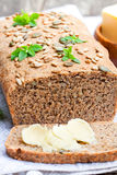 Homemade  sliced  rye bread with sunflower seeds and fresh butter Stock Photos