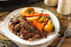 Homemade Slow Cooker Pot Roast. With Carrots and Potatoes Stock Photo
