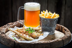Homemade smelt fish with chips and cold beer Stock Photography