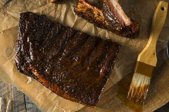Homemade Smoked Barbecue St. Louis Style Pork Ribs. With Sauce stock images