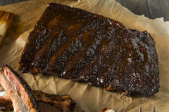 Homemade Smoked Barbecue St. Louis Style Pork Ribs. With Sauce stock photo