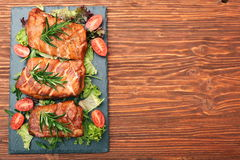 Homemade smoked ham on a board Stock Photos