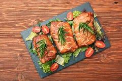 Homemade smoked ham on a board Royalty Free Stock Photo