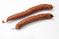 Homemade smoked sausage on a white background Royalty Free Stock Images