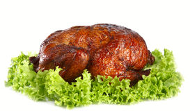 Homemade smoked whole chicken on leaf lettuce bed Stock Photography