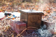 Homemade smokehouse. For preservation of fish in action royalty free stock photo