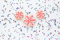 Homemade  snowflake Christmas cookie on festive background. Stock Photo
