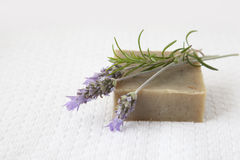 Homemade Soap. With lavender and rosemary over white towel background royalty free stock image
