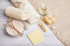 Homemade soap, dry lavender flowers and essential oil. Top view. Natural cosmetic oil, sea salt and handmade soap, towel on light background. Aromatherapy, spa stock photography